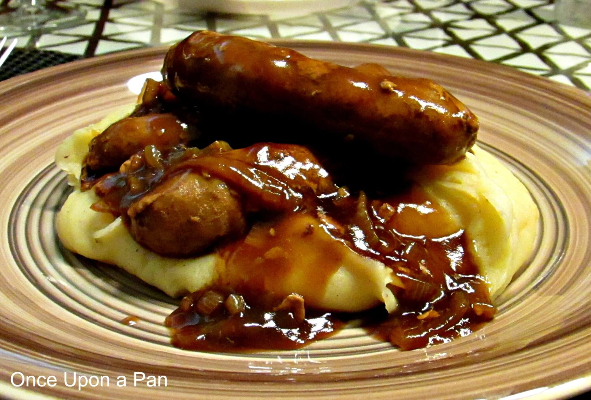 Bangers and mash with Guinness onion gravy